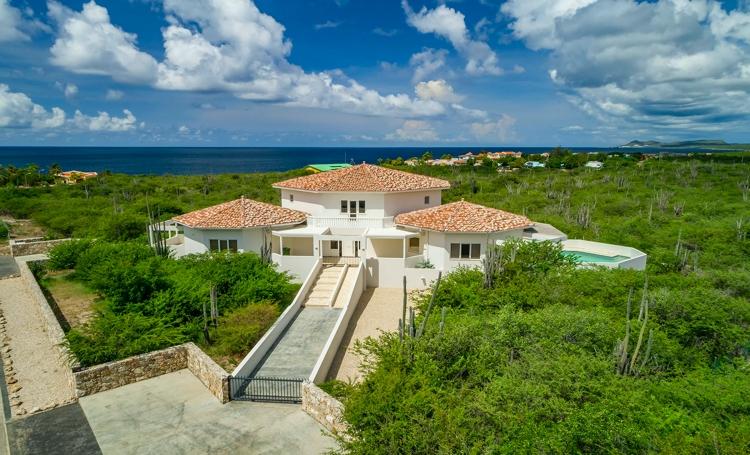 Deze afbeelding heeft een leeg alt-attribuut; de bestandsnaam is caribbean-homes-Shores-69-1.jpg